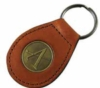 Leather key ring with metal embossed logo